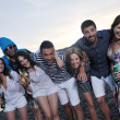 Group of young enjoy summer party at the beach — Stock Photo #6023497