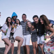 Group of young enjoy summer party at the beach — Stock Photo #6023504