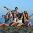 Happy young group have fun on beach — Stock Photo #6023667