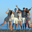Happy young group have fun on beach — Stock Photo #6023709