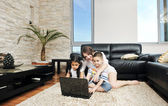 Family wathching flat tv at modern home indoor — Zdjęcie stockowe