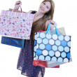 Happy young adult women  shopping with colored bags - Stock fotografie