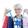 Happy young adult women shopping with colored bags — Stock Photo #6251176