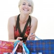 Happy young adult women shopping with colored bags — Stock Photo #6252084