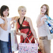 Happy young adult women shopping with colored bags — Stock Photo #6252930