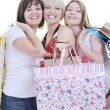 Happy young adult women shopping with colored bags — Stock Photo #6253269