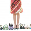 Stock Photo: Pretty young woman with buying shoes addiction, isolated on whit