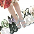 Pretty young woman with buying shoes addiction, isolated on whit — Stock Photo