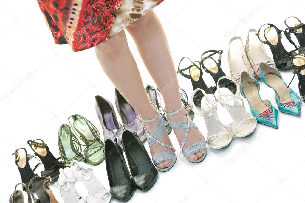 Woman buy shoes concept of choice and shopping, isolated on white background in studio — Stock Photo #6257915