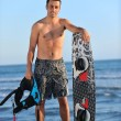 Portrait of a young kitsurf man at beach on sunset — Stock Photo #6310502