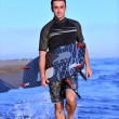 Portrait of a young  kitsurf  man at beach on sunset — Stock Photo