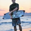 Portrait of a young  kitsurf  man at beach on sunset - Foto Stock