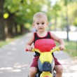 Children in park ride cycle at park — Foto Stock