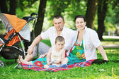 Family at park relaxing and have fun — Stok fotoğraf