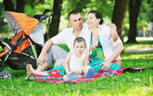 Family at park relaxing and have fun — 图库照片