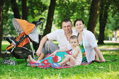 Family at park relaxing and have fun — Stock Photo