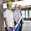 Team of architects on construciton site — Stock Photo #6680867
