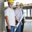 Team of architects on construciton site — Stock Photo #6680904