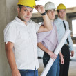 Team of architects on construciton site — Stock Photo #6680962