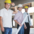Team of architects on construciton site — Stock Photo #6680975