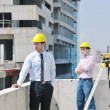 Team of architects on construciton site — Stock Photo #6683143
