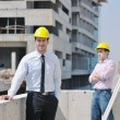 Team of architects on construciton site — Stock Photo #6683231