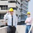 Team of architects on construciton site — Stock Photo #6683350
