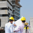 Team of architects on construciton site — Stock Photo #6684295