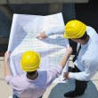 Team of architects on construciton site — Stock Photo #6688758