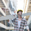 Stock Photo: Hard worker on construction site