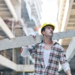Hard worker on construction site - Foto Stock