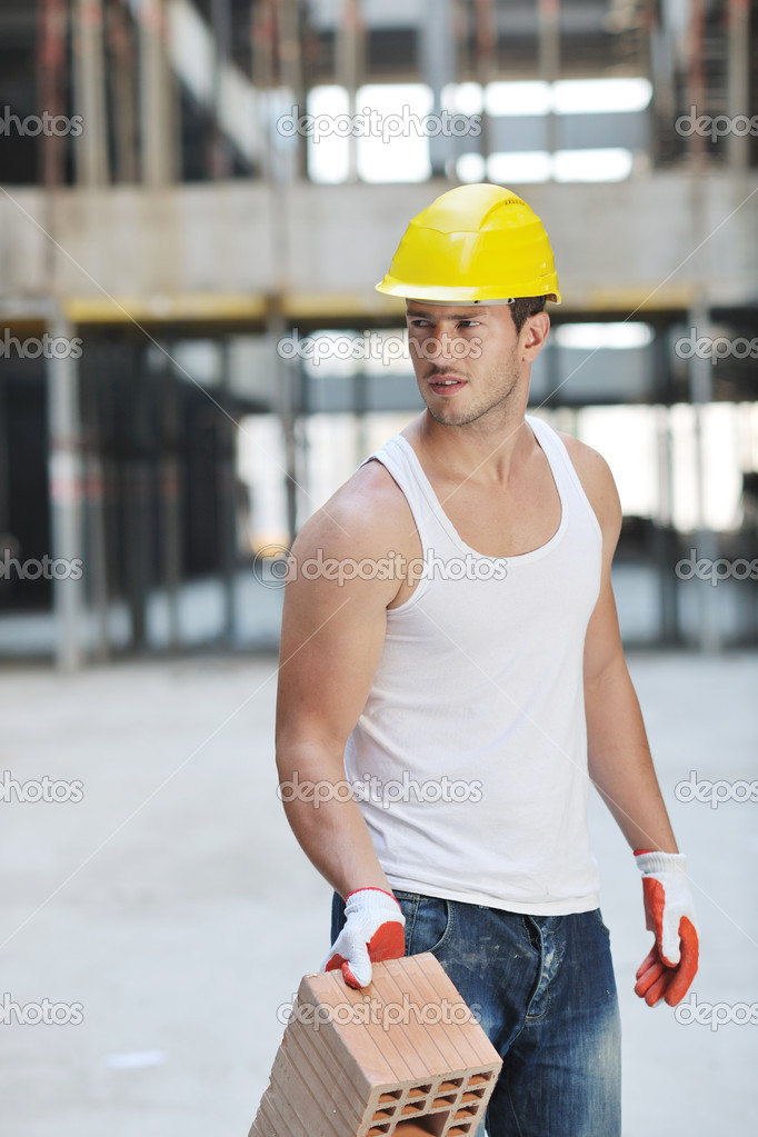 Handsome hard worker portrait at concstruction site  Stok fotoraf #6718892