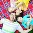 Happy young couple with their children have fun at park — Stock Photo #6720045