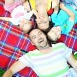 Happy young couple with their children have fun at park — Stock Photo #6720726