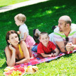 Stock Photo: Happy young couple with their children have fun at park
