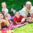 Happy young couple with their children have fun at park — Stock Photo #6723072