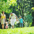 Happy young couple with their children have fun at park — Stock Photo #6725498
