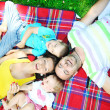 Happy young couple with their children have fun at park — Stock Photo #6728811