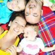 Happy young couple with their children have fun at park — Stock Photo #6729478
