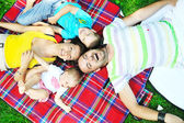 Happy young couple with their children have fun at park — Foto de Stock