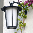 Stock Photo: Old lamp on the wall