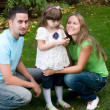 Family in garden — Stock Photo #6454439