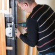 Handyman repairing lock — Stock Photo #6454447