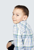 Portrait of a boy on a gray background. — Stock Photo
