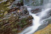 Waterfall in red stones — Stock Photo