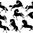 Royalty-Free Stock Vector Image: Nine horse silhouette set