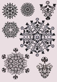 Black snowflakes collection on pink — Stock Vector