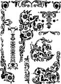 Set of curled ornament elements — Stock Vector