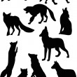 Fox and wolf silhouettes — Stock Vector