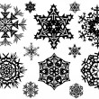 Set of black snowflakes — Stock Vector